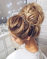 this beautiful high bun wedding hairstyle for any wedding