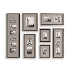 decorating black collage picture frames on cream wall for home