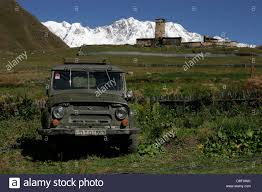 uaz jeep old russian uaz jeep stone towers and traditional houses in