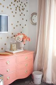 coral and gold love the dresser and the striped curtains lovely