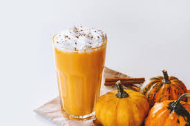 small pumpkins pumpkin smoothie small pumpkins and drink on the white background