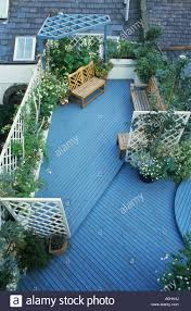 roof garden london blue decking trellis fencing bench and climbing