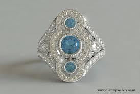 art deco three stone round cut aquamarine diamond ring new zealand