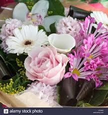 pink white bouquet of rose calla hyacinth gerbera in kraft
