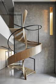 a sculptural spiral staircase makes a statement in this home u0027s