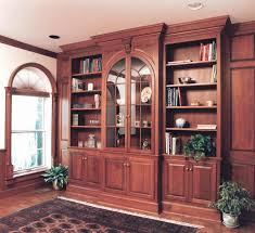 wall library hand made cherry library wall with arched glass doors by odhner