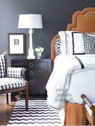 black and white hotel linen orange headboard house decor