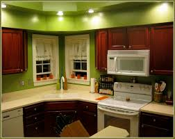 good kitchen colors with light wood cabinets dark green painted kitchen cabinets black and white dual tone