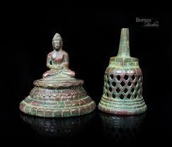 bronze meditating buddha in an open stupa 5