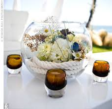 beachy centerpieces nautical rope created the base for beachy centerpieces filled with