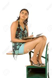 Picture Of Student Sitting At Desk Female College Student Sitting On Desk With Notebook Stock Photo