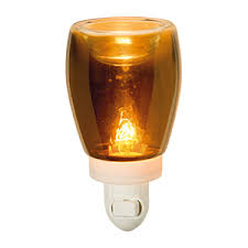 plug in candle night light subtle amber glass casts a moody glow reminiscent of softly glowing