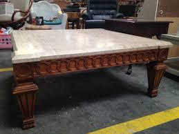 beige granite top heavy wood coffee table u2013 in good condition