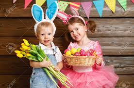 kids easter happy kids boy and girl dressed as easter bunnies laughing with