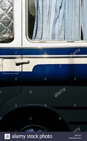 curtain at the window of a caravan bus munich bavaria germany