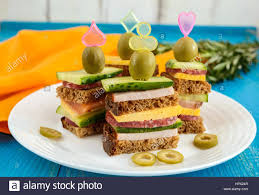 mini canape mini sandwiches canape with fresh cucumbers ham cheese olives