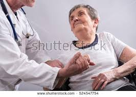 Doctor Comforting Patient Free Doctor Visiting Elderly Patient At Home Photos Avopix Com