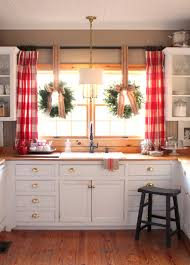 Christmas Decorating Ideas For Top Of Kitchen Cabinets by Christmas In The Kitchen Wreaths In Window With Jute Bows And