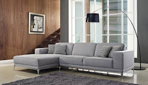 furniture modern living room design with black leather contemporary sectional sofas with gray shag rug and modern floor lamp for modern living room design