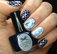 white and blue marble nail art