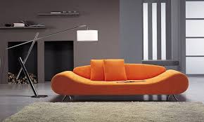 interior brown rug also bright contemporary orange sofa paired