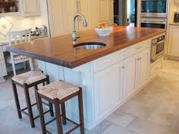kitchen island with seating and stove tile flooring kitchen sink