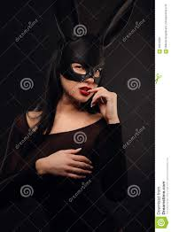 beautiful charming woamn in black rabbit mask and elegant