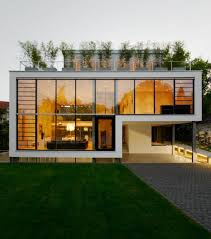 modern white and warm nuance of the house with modern windows
