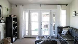 front door window treatments black and white living room features traditional drapes window