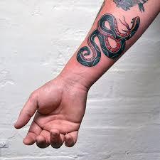 Snake Forearm - 70 traditional snake designs for slick ink ideas