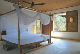 beach style beds minimalist beach bedroom with canopy bed frame also light hearted