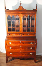 an elegant american federal mahogany and inlaid secretary or