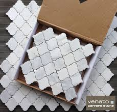 carrara venato arabesque tile white based marble cut into