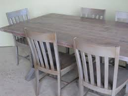 hand made trestle dining room table with driftwood finish by