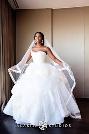 tiwa savage is a stunning bride in a vera wang wedding dress