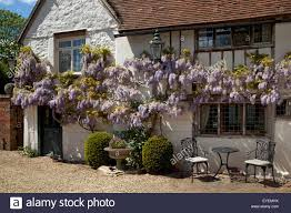 Tudor Style Cottage Traditional White English Stone Cottage With Pale Grey Picket