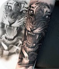realism style colored forearm of roaring tiger