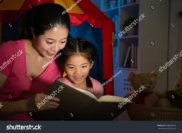 sweet attractive little reading story stock photo 648043240