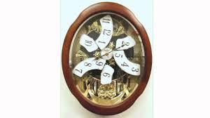 rhythm anthology legend magic motion musical clock pecan finish