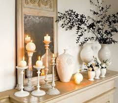 Home Decor With Candles | pretty mantle display with white candlesticks and vases candle