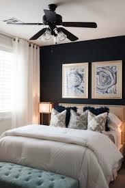bedroom black ceiling fan with light blue bedside bench white