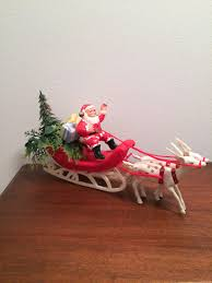 vintage christmas santa in sleigh with reindeer tree and presents