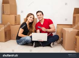 Good Inexpensive Furniture Good Looking Hispanic Couple Buying Furniture Stock Photo