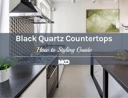 white kitchen cabinets and black quartz countertops trend alert black quartz countertops how to style guide mkd