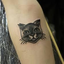 38 cute cat tattoo examples penguin