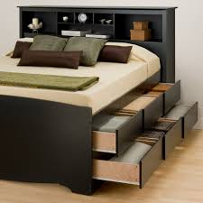 a bed with storage like brimnes helps maximize the storage space