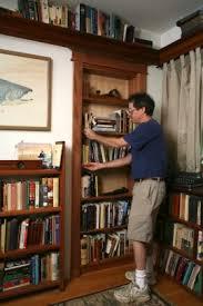 Bookcase In Wall Hidden Pivot Bookcase Installation Thisiscarpentry