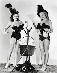 vintage black and white halloween images barbara hale u0026 myrna dell adding bits to their brimming cauldron