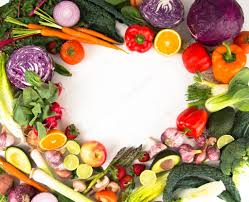 assortment of fresh vegetables and fruits making heart shape frame