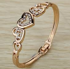 gold heart bangle bracelet images Rose gold plated five hollow heart bangle bracelet fudgified jpg
